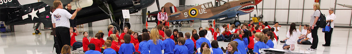 Docent lead tour as part of the Warhawk Air Museum education center for a school field trip