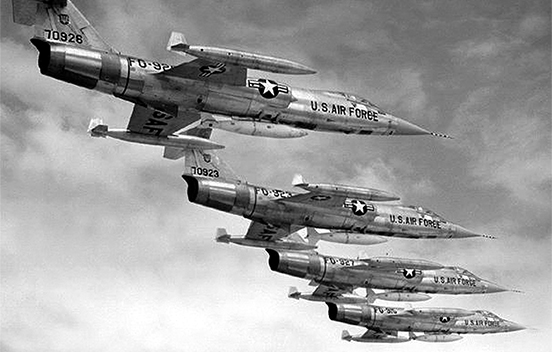 four Lockheed F-104 Starfighters flying in formation