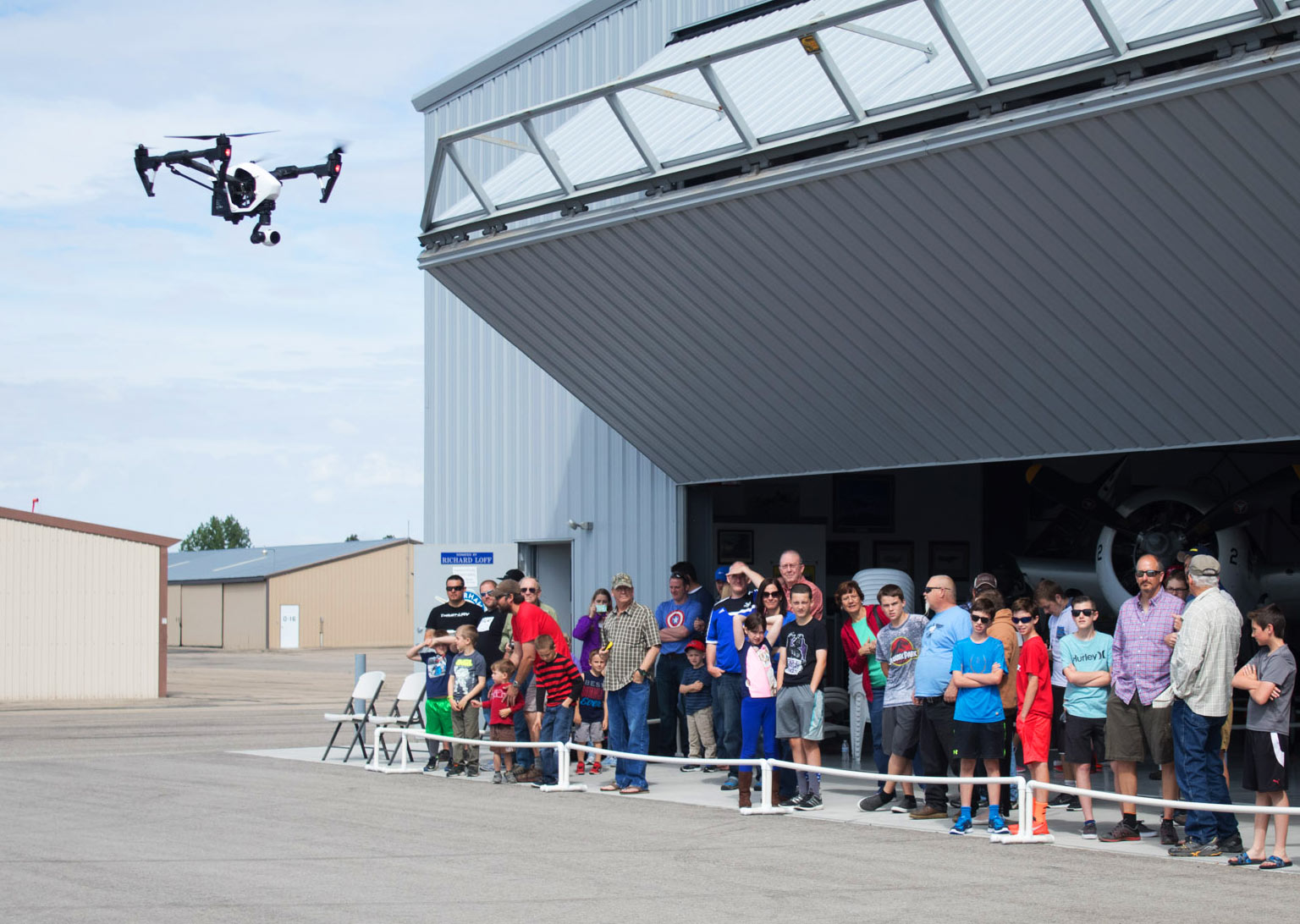 Kids and Adults watching a drone fly by at Warhawk Drone Days