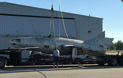 Grumman F9F Panther arriving at Warhawk Air Museum for restoration and display