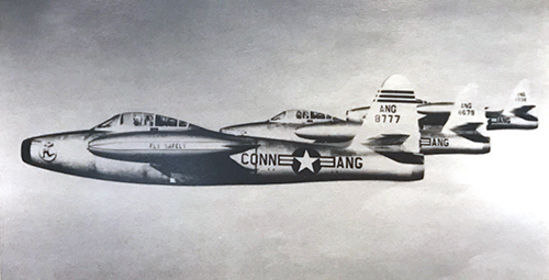 Three F-84D Thunderjetss with the Flying Yankee markings flying in formation