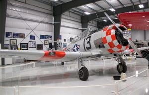 An AT-6 Harvard plane parked inside the Warhawk Air Museum