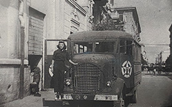Carmelita Pope next to the troupe's transport bus