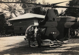 John Hoye standing in front of his HH-43F