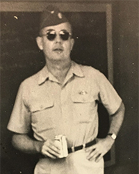 John Hoye, standing in uniform